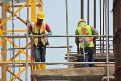 Construction workers working at high level Royalty Free Stock Image