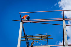 Construction workers working on high. Royalty Free Stock Images