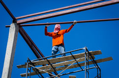 Construction workers working on high. Stock Photo