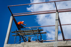 Construction workers working on high. Stock Image
