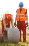 Construction workers working outdoor Royalty Free Stock Photos