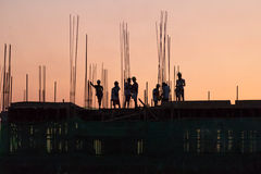 Construction workers working overtime Royalty Free Stock Images