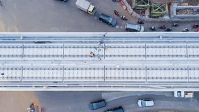 Construction workers working on railway tracks. JAKARTA - Indonesia. May 21, 2018: Top view of construction workers working on railway tracks for Jakarta Light Royalty Free Stock Images