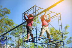 Construction workers working on scaffolding. Construction workers working on scaffolding Royalty Free Stock Image