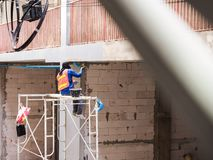 Construction workers are working. On scaffolding Stock Image