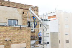 Construction workers working on scaffolding in Barcelona Royalty Free Stock Images