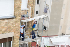 Construction workers working on scaffolding in Barcelona Royalty Free Stock Image