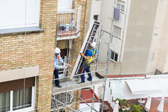 Construction workers working on scaffolding in Barcelona Royalty Free Stock Photography