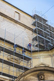 Construction workers working on scaffolding in the Vatican City royalty free stock photography