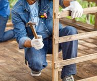 Construction Workers Working In Wooden Cabin Stock Images