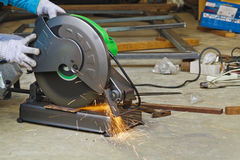 Construction working with cutting grinder Royalty Free Stock Photo