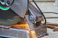 Construction working with cutting grinder Stock Photo