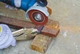 Construction working with cutting grinder & pliers Stock Images