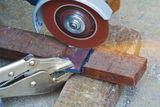 Construction working with cutting grinder & pliers Royalty Free Stock Photo