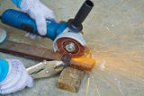 Construction working with cutting grinder & pliers Stock Photo
