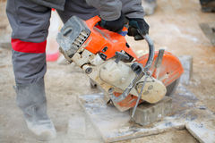 Construction. Working Power cutters cut paving tile cement dust boots form overalls stock images