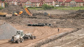Construction working process. Construction site. Bulldozer aligns the large pile of clay on construction site. Construction working process. Construction site stock video
