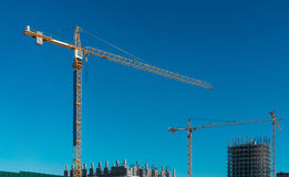 Construction workplace with a yellow crane Royalty Free Stock Photos