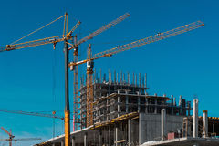 Construction workplace with a yellow crane Royalty Free Stock Photo