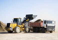 Construction works. Excavators and trucks in work Stock Photography