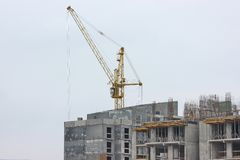 Construction works of modern low-rise residential buildings. construction site at the house. cranes, special equipment royalty free stock photos