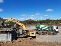 Free Construction Works Ongoing, Worksite With Workers And Heavy Machines. Stock Image - 188975601