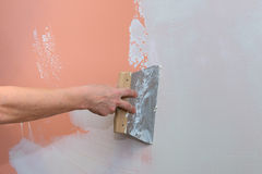 Construction works, putty and leveling walls Stock Image