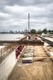 Construction works at the Schelde docks in Antwerp, Belgium. Construction works at the docks of the Schelde river with the Antwerp skyline in the background Stock Image