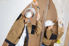 2 construction wrokers working with hammer and chisel. 2 royalty free stock photo