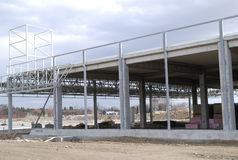 Construction yard. Unfinished building on construction yard Stock Image