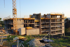 Construction yard. Concrete walls, crane and building accessories royalty free stock photography