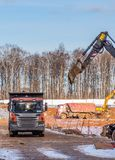 Construction of the zero cycle of the new residential complex `in the forest`. construction machinery levels . Moscow royalty free stock photos