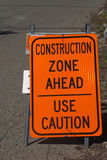Construction Zone Sign. Construction zone ahead use caution sign on the side of the road royalty free stock image