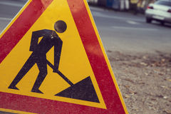 Construction zone. Sign by the road in street scene Royalty Free Stock Photography