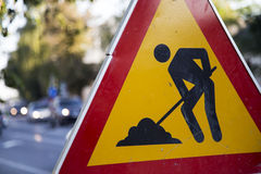 Construction zone sign. By the road in urban environment stock photo