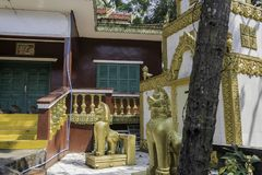 Constructions around the Buddhist temple Wat Leu with its guardian lions Sihanoukville Cambodia. Constructions around the Buddhist temple Wat Leu with and its Royalty Free Stock Photo