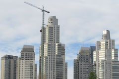 Constructions of buildings. Cranes building skyscrapers in the city Stock Photo