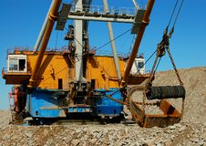 Constructions of dragline. Conctructions of dragline in open cast mining quarry Stock Photo