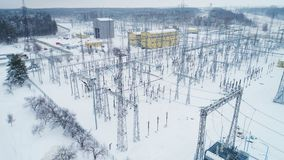 Constructions and supports with electrical wires at distribution substation. Upper view steel constructions and high supports with electrical wires transmitting stock video