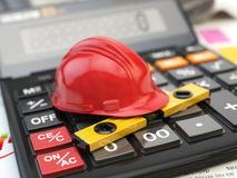 Constructions tools hardhat and level on calculator. Concept of. Calculation of  costs of construction. 3d illustration Stock Photo