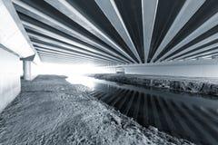 Constructions under the bridge. Royalty Free Stock Photo