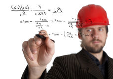 Constructor. An image of constructor in a rad helmet writing with a pen Stock Images