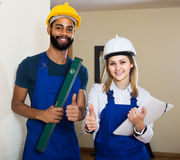 Constructor and builder with spirit level at site Royalty Free Stock Photo