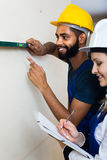 Constructor and builder with spirit level at site Stock Photos