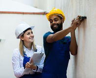 Constructor and builder with spirit level at site Royalty Free Stock Image