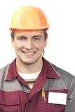 Constructor con la etiqueta conocida en blanco Foto de archivo