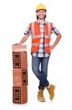 Constructor con los ladrillos de la arcilla Foto de archivo