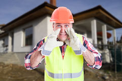 Constructor on construction site screaming something. Constructor on construction site with protection equipment screaming or announcing something Stock Photography