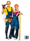 Constructor de la gente del grupo con las herramientas de la construcción. Imágenes de archivo libres de regalías