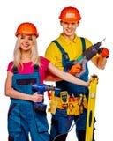 Constructor de la gente del grupo con las herramientas de la construcción Foto de archivo libre de regalías